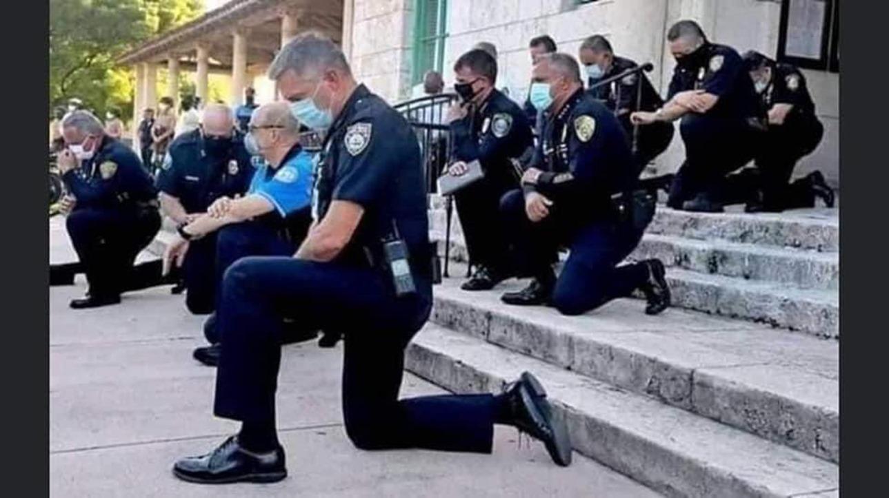 BLM_cop_kneeling